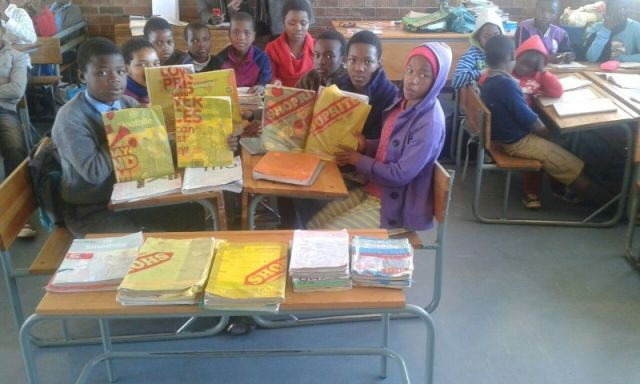 Learner show off their plastic book covers